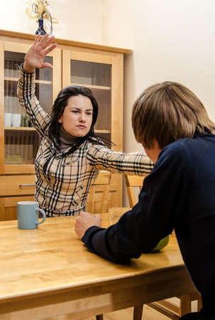 Wife quarrels with her husband in the kitchen photo