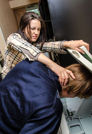 revenge: Office revenge  Woman tries to shove the man in the copy machine