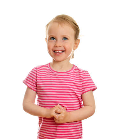 Smiling little girl portrait isolated on white background photo