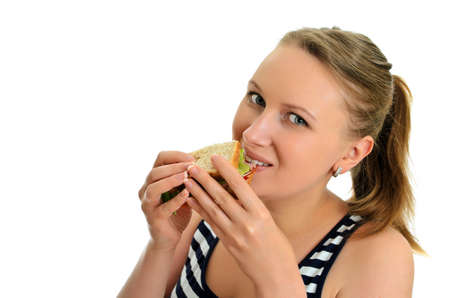 Attractive female eating sandwich, isolated on white photo