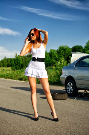 Desperate girl calling to car repair service photo