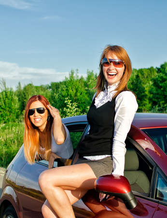 Two pretty happy girls in the car. Concept of carefree roadtrip Stock Photo - 14201254