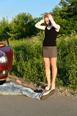 Young girl knocked down a man on a road photo