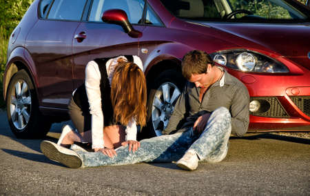 unconscious: Woman and man on a road. Concept car accident Stock Photo