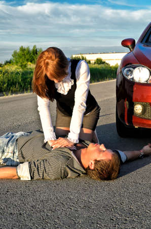 reanimation: Young man reanimation on a road. Concept first aid