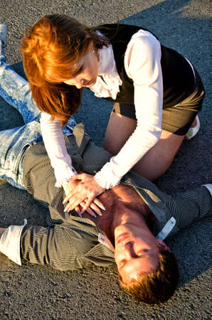Young man reanimation on a road. Concept first aid photo