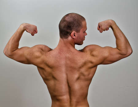 The muscular bodybuilder back. On grey background. Stock Photo - 14265313