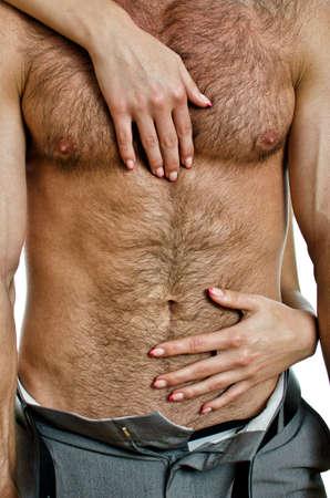 Female hands unbuckle mans pants. Stock Photo - 14427838