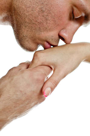beso: El hombre besa la mano de la mujer. Aislado en blanco. Foto de archivo