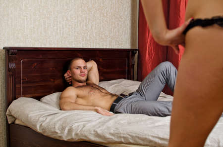 Intimate couple before foreplay in bed. Stock Photo - 14427834