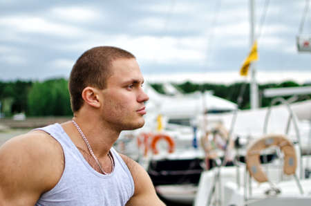 Portrait of attractive male against yachts. photo