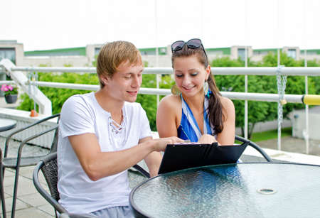 Happy couple ordering food in summer cafe Stock Photo - 14427726