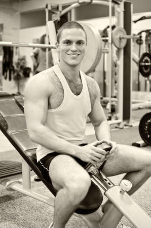 Portrait of a smiling bodybuilder in fitness club photo