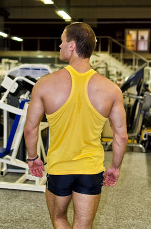 Bodybuilder in a gym from the back Stock Photo - 14584084