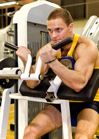 Man doing athlete exercise in fitness club Stock Photo - 14583915