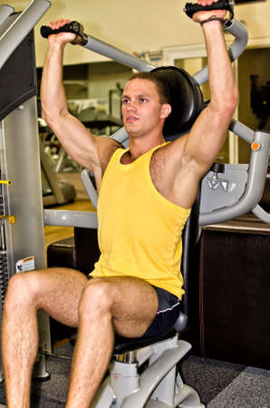 Man doing athlete exercise in fitness club Stock Photo - 14583927