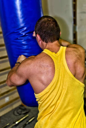 Man doing athlete exercise in fitness club Stock Photo - 14584021