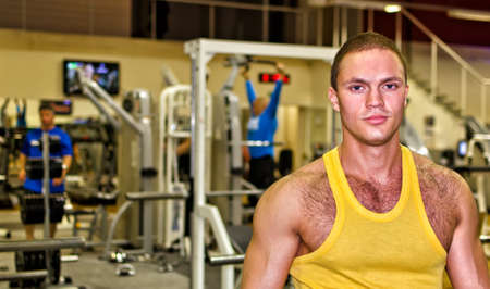 Portrait of handsome bodybuilder in fitness club Stock Photo - 14584022