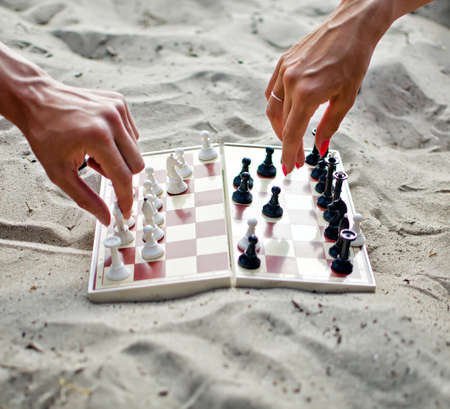 Image of human hands with chess figure making move Stock Photo - 14716262
