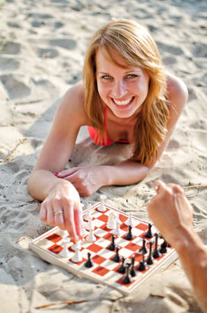 Portrait of pretty woman playing chess on the beach Stock Photo - 14716313