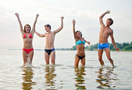 Friends having fun in the sea Stock Photo - 14716258