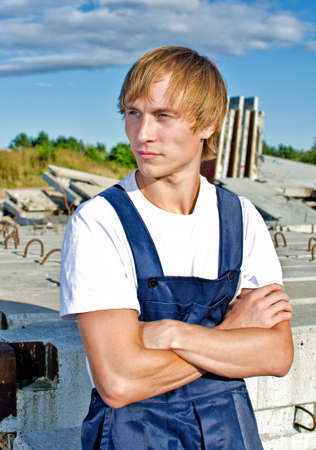 coveralls: Handsome builder in coveralls on construction site