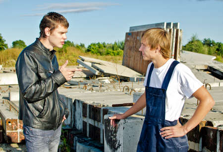 Boss giving instructions to builder at construction site Stock Photo - 14854969