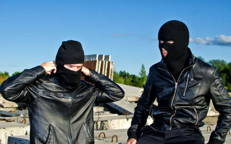 Two criminals getting ready for robbery Stock Photo - 14854977