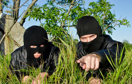 balaclava: Two criminals getting ready for offense