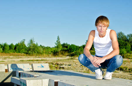 hunker: Handsome man posing on construction site