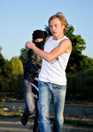 Thief in mask stealing a backpack Stock Photo - 14854940
