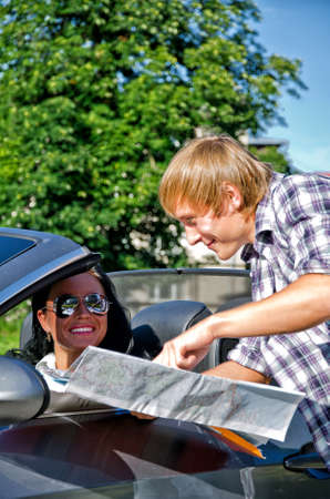 Male tourist asking female driver about direction photo