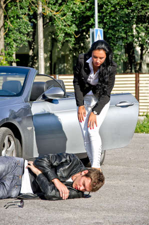 Female driver knoched down male pedestrian photo
