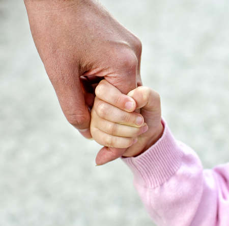 loving hands: Child holding mothers hand