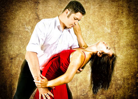 Cute young couple dancing latino photo
