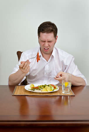 Man is disappointed with his dish photo