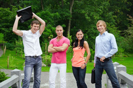 Group of cheerful students in the park photo