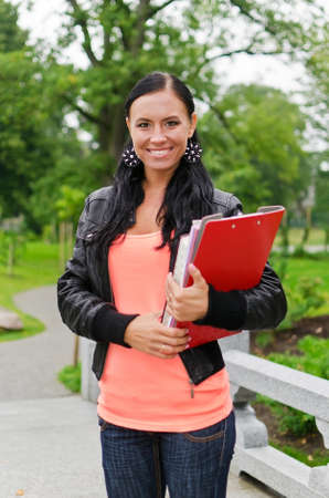 Portrait of smiling female student outdoors photo
