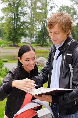 Two students studying outdoors Stock Photo - 15148690