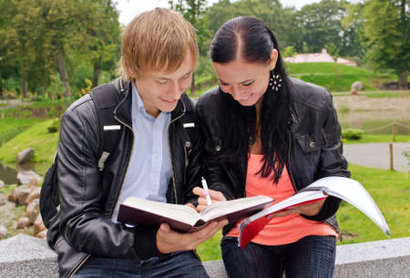Two students studying outdoors Stock Photo - 15148679