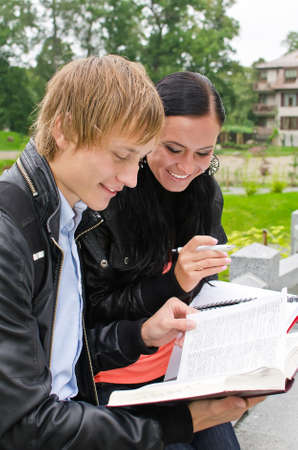 Two students studying outdoors Stock Photo - 15148626
