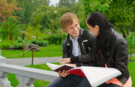 Two students studying outdoors Stock Photo - 15148676
