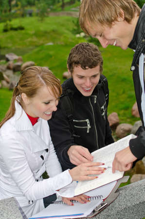 Group of students studying outdoors photo