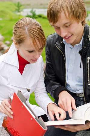 Two students studying outdoors Stock Photo - 15148189