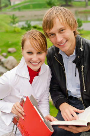 Two students studying outdoors Stock Photo - 15148202