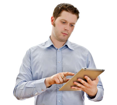 Handsome serious man with tablet computer. Isolated on white photo