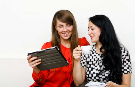 Two young woman using tablet pc Stock Photo - 15303701