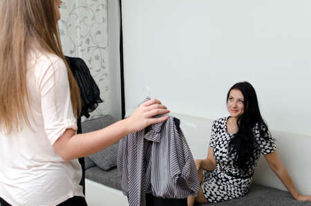 Girl helps her friend choose the dress Stock Photo - 15303937