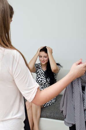 Girl helps her friend choose the dress Stock Photo - 15303930