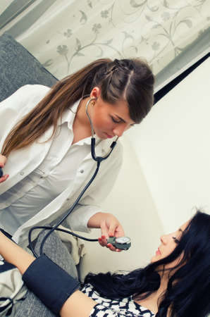 Female doctor measures patient photo